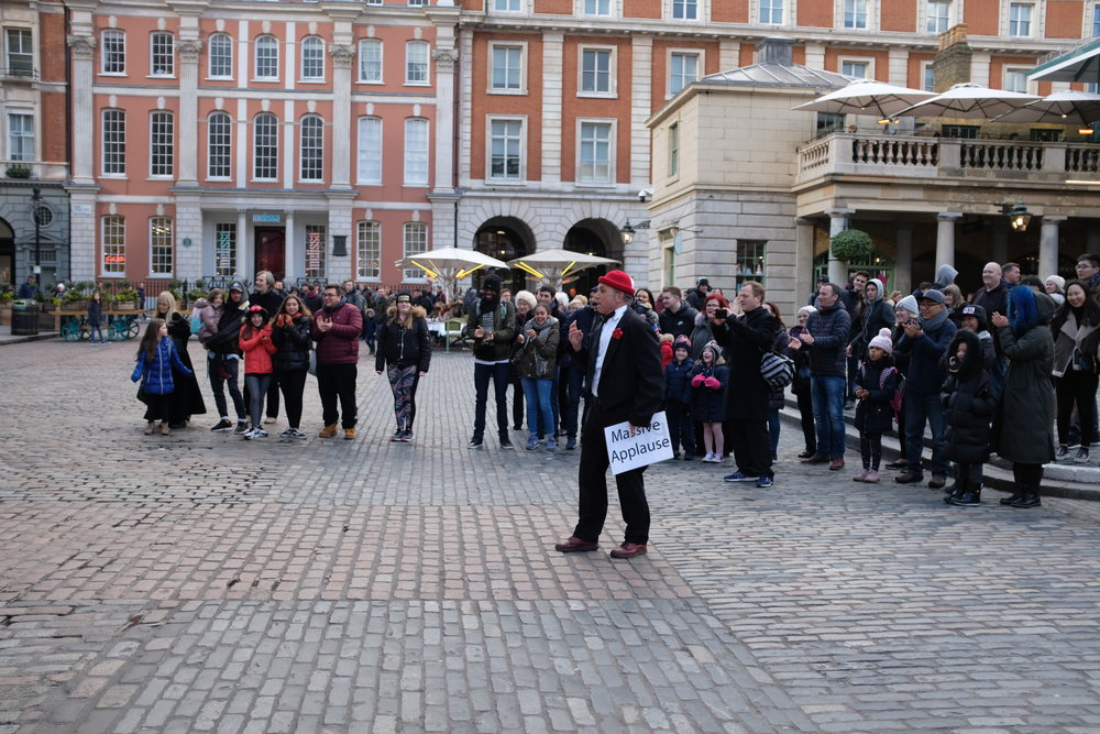 The main stage in Covent Garden for non-musicians is the West Piazza, in front of St. Paul's Church. Even though performers seem to carry on their act in front of the church, which is a public property, they are still within the boundaries of Covent Garden's private property.