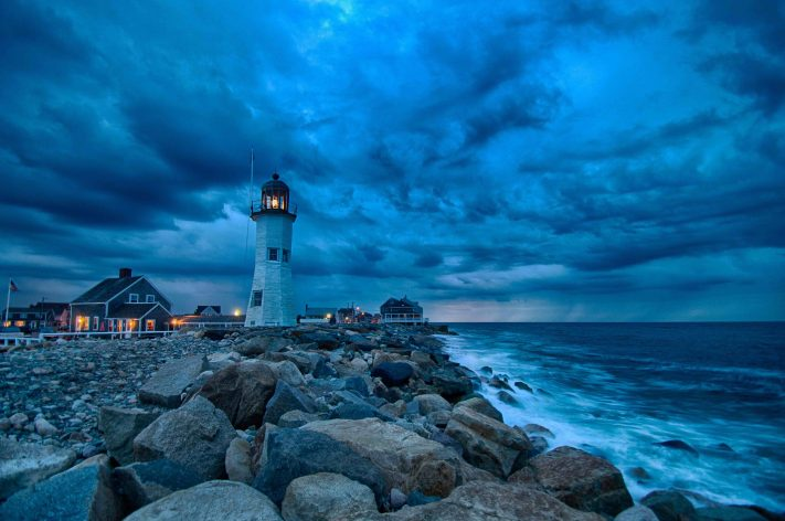 Rough weather and fantastic clouds at dusk in Scituate, Massachusetts, a coastal town is guarded by the Old Scituate Light.