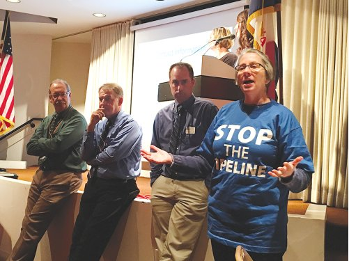 Carolyn Raffensperger speaks at IDNR public comments meeting in Des Moines, Dec 2015. The state agency will release a decision this year on Dakota Access, LLC's permit to construct a crude oil pipeline underneath three Iowa rivers and through a public wildlife area. (Mike Mendenhall/Daily News) Source: http://bit.ly/20pqrgF