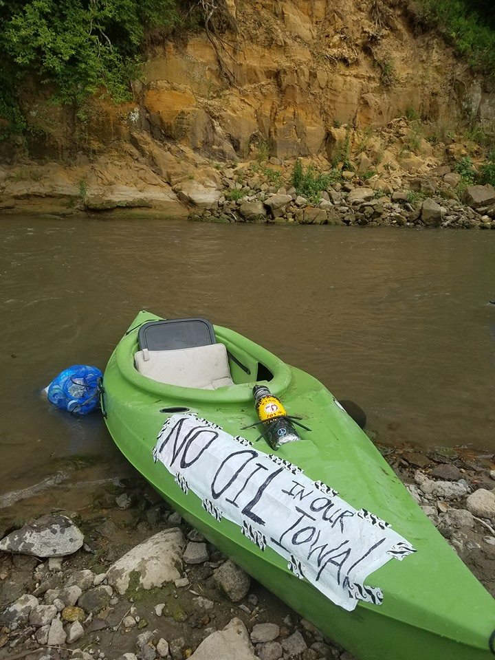 kayak-in-river-no-oil-in-our-Iowa.jpg
