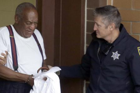 cosby-sept-25-handcuffs-jail-door.jpg