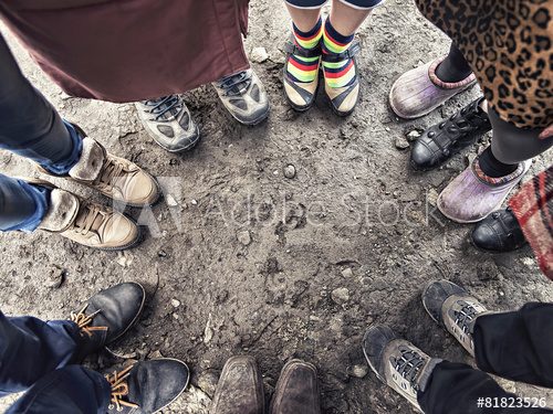 Adobe Stock_818235526_feet of people standing in a circle.png