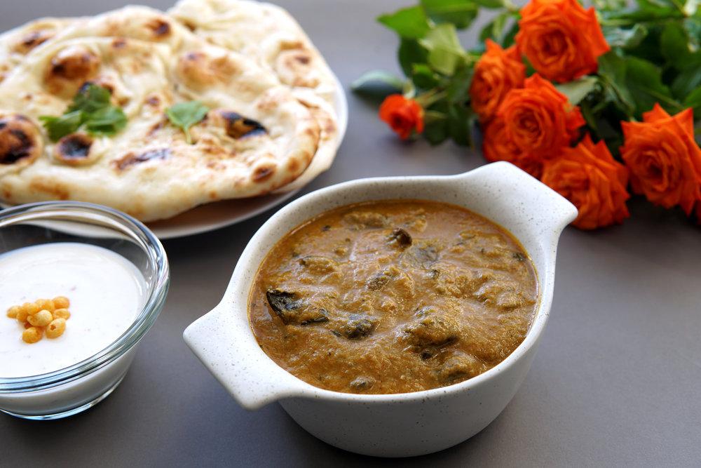 Mushroom Masala served with Naan and Boondi Raita.