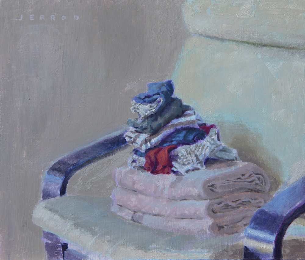 Clothes and towels on beige chair copy.jpg