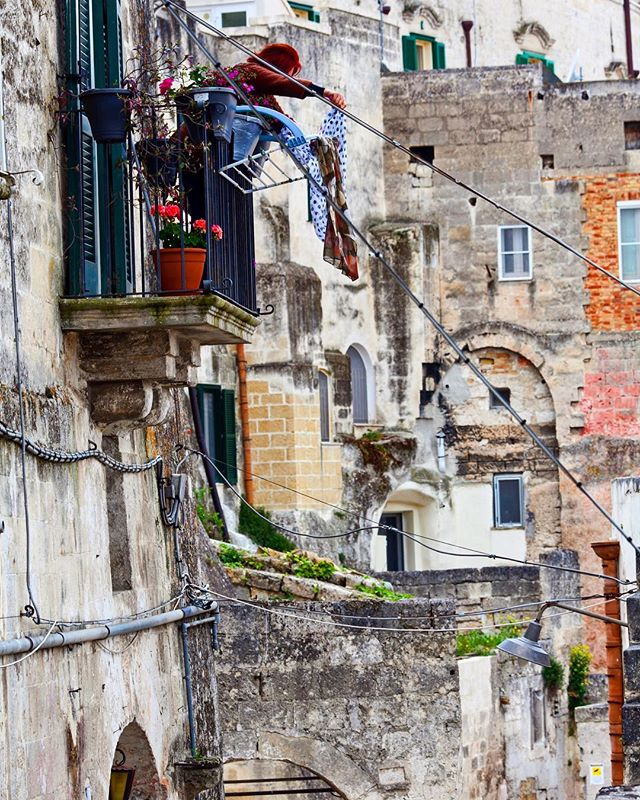 Traveling through Italy has led me to believe there is no greater place to shake a rug than over an iron balcony railing. . Sammy Faze Photography 2018 . #sammyfazephotography#italy#matera#italia#travel#traveler#travelgram#wanderlust#exploretocreate#gramslayers#illgrammers#rawurbanshots#shotzdelight#streetshared#street#justgoshoot#europe#europetrip#travelphotography#travelphoto#createexplore#lensculture#moodygrams#italian#bartender#depthobsessed#chicagogrammers#agameoftones#heatercentral