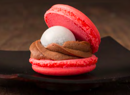 Mini Raspberry Macaron Oyster - An open raspberry macaron lled with chocolate mousseline, raspberry jam and white chocolate pearl.Contains: Soy, Milk, Egg, Almond