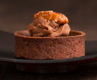 Turtle Tartlette - Sweet chocolate tart shell lled with caramel and toasted pecan. Finished with chocolate glaze, chocolate mousseline and a candied pecan.Contains: Wheat, Soy, Milk, Egg, Pecan