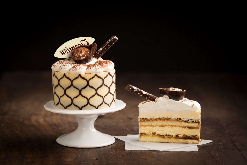 Tiramisu - Our Tiramisu has vanilla genoise soaked with co ee syrup, and layered with a light mascarpone cream. Topped with fresh whipped cream and lightly dusted with cocoa powder. Finished with chocolate decoration.Contains: Wheat, Soy, Milk, Egg