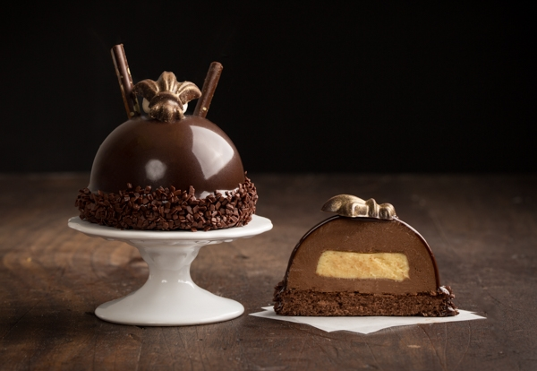 Bourbon Chocolate Bombe - Dark chocolate genoise imbibed with bourbon syrup, 64% chocolate mousse with a bourbon Bavarian cream and covered with dark chocolate icing, nished with hand-painted chocolate eur-de-lys in gold.Contains: Wheat, Soy, Milk, Egg