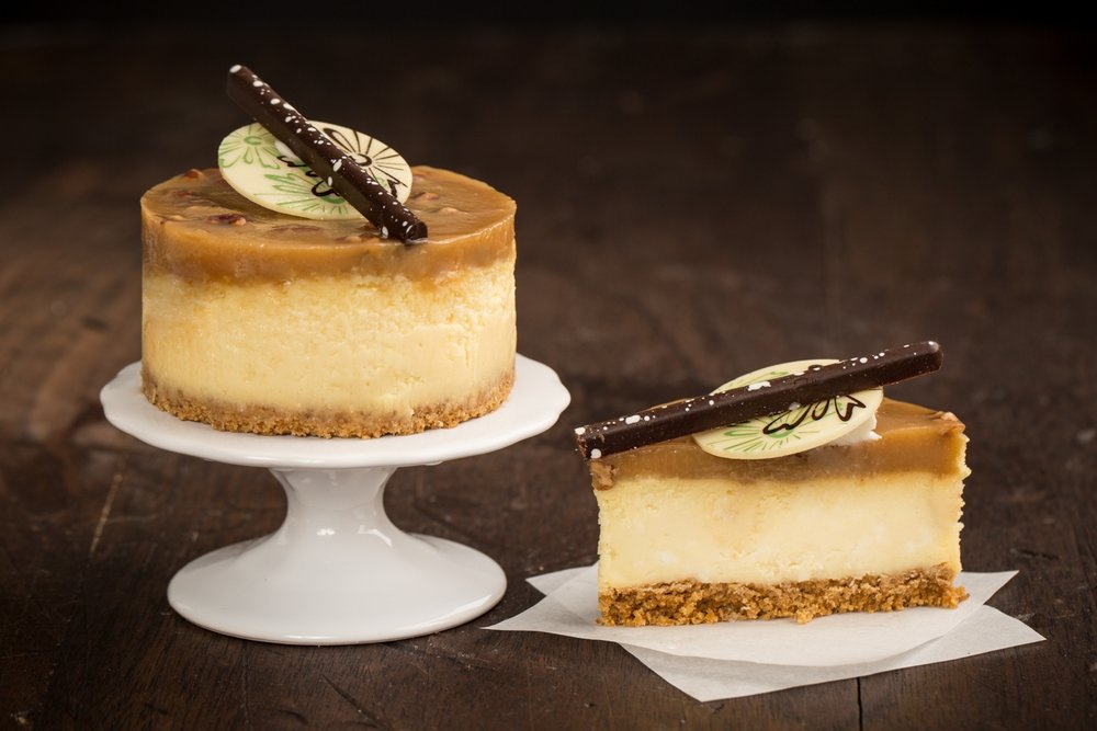 Bourbon Pecan Caramel Cheesecake - A Bourbon cheesecake on a layer of graham cracker crust, topped with bourbon caramel pecan icing.Contains: Wheat, Soy, Milk, Egg, Pecan
