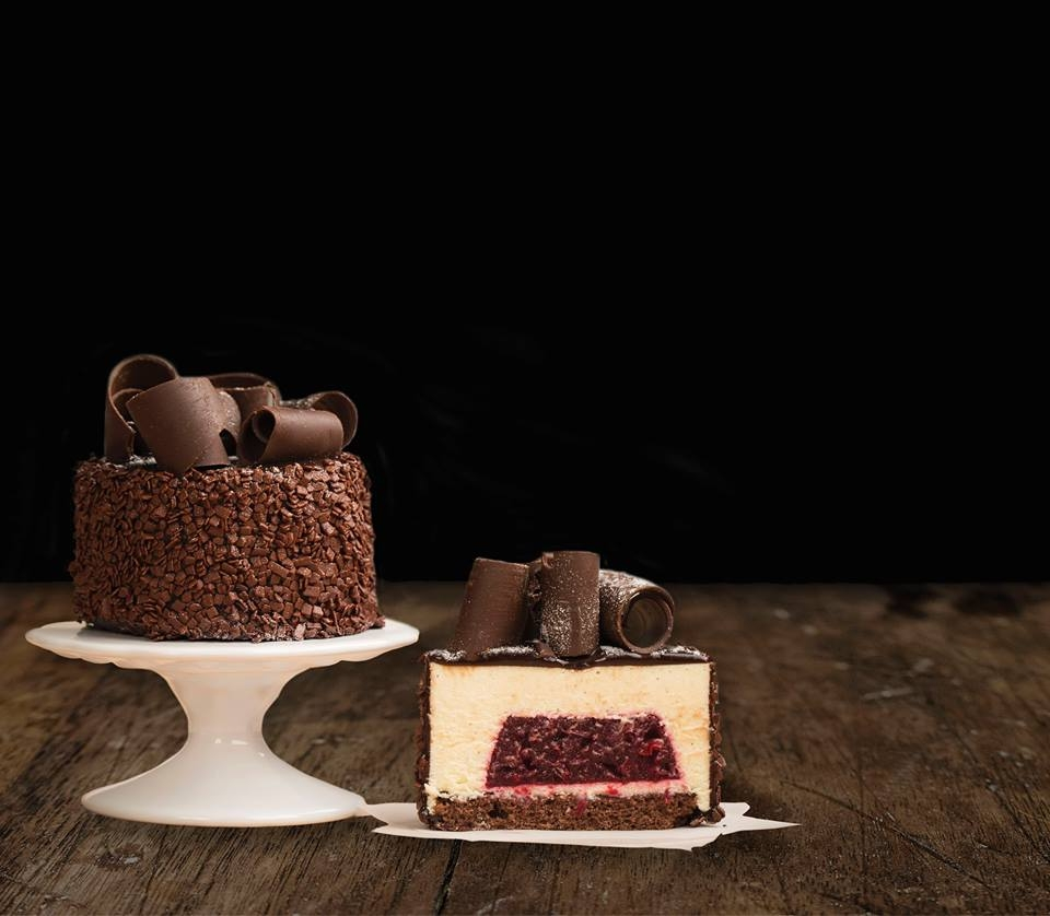 Red Velvet Cake - This masterpiece has dark chocolate genoise, soaked with kirsch syrup, layered with white chocolate vanilla Bavarian cream, center with Morello cherry, chocolate icing and chocolate curl.Contains: Wheat, Soy, Milk, Egg