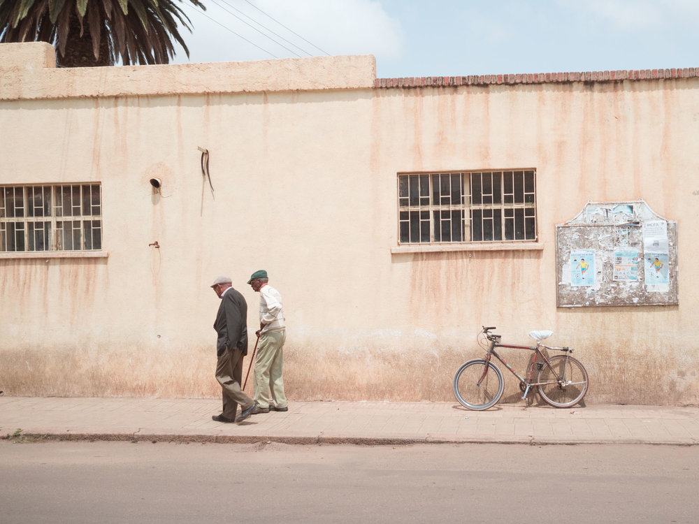 Two old men walking in the streets of Asmara, Eritrea.