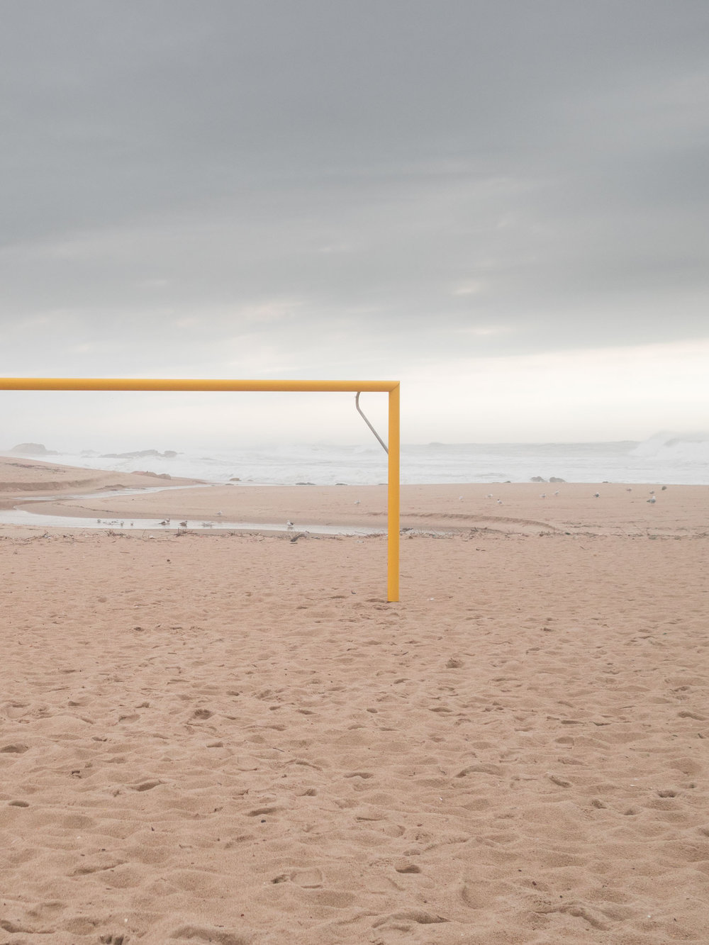 Empty football goal on a beach in Portugal.