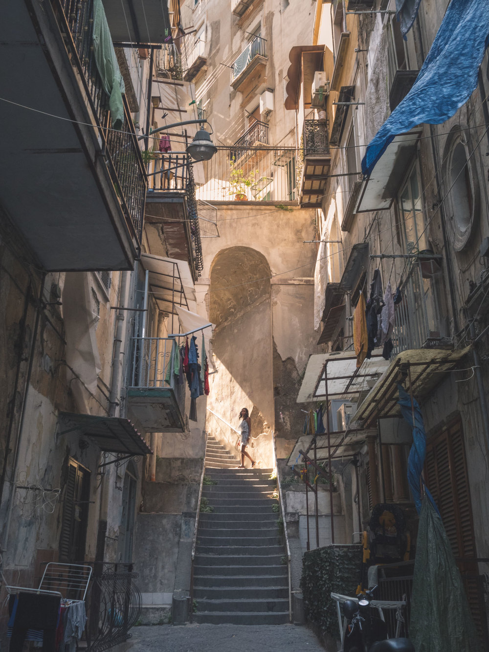 In the alleys of the Sanità. Magical lightbeam. Napoli, Italy.