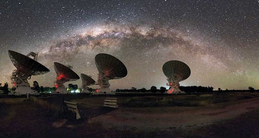 Radio telescopes observing the night sky. (Credit: Alex Cherney)