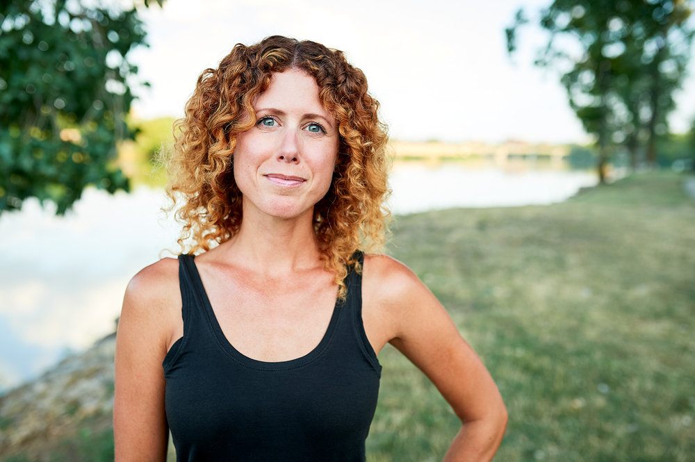 """Jenna Goodman     What do you like to do outside in Kansas?    """"My favorite ways to adventure in Kansas include kayaking the Kaw & hiking the Wetlands with my pup, Millie."""""""