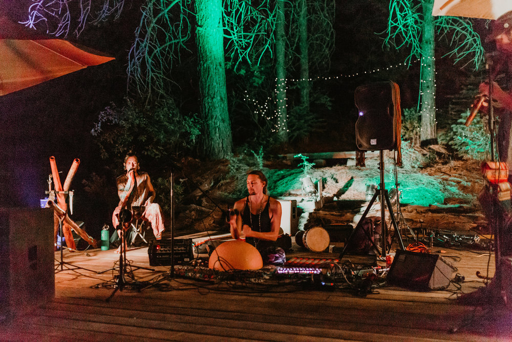 The Air Nomads  playing on the land for Gaia's wedding in summer 2018
