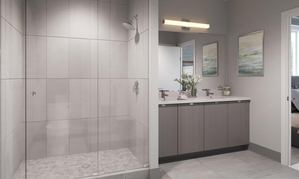 """Baths - Moen rain shower in master bathMoen single lever faucetsPorcelain bathtub in secondary baths (per plan)12"""" x 24"""" porcelain tile in master baths; 12"""" x 12"""" porcelain tile in secondary bathsContemporary flush panel frameless vanity cabinets"""