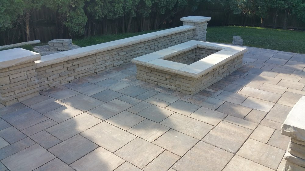 Outdoor fireplace landscape design in Northbrook, IL