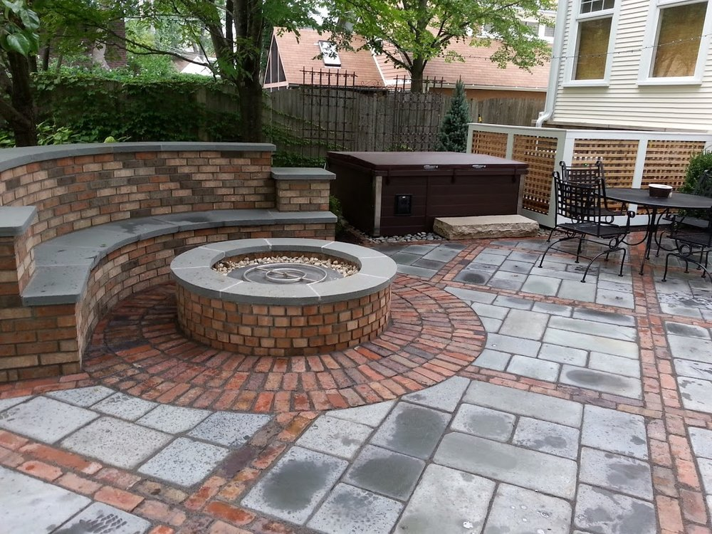 Outdoor fireplace, patio pavers by landscape contractors in Northbrook, IL