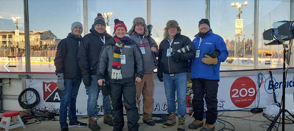 Minnesota Hockey crew left to right: Declan Goff, Brian Halverson, Scott Tiffany, Johnny Watkins, Jeff Wegge, and Tim Kolehmainen. Missing is Bill Rossini.