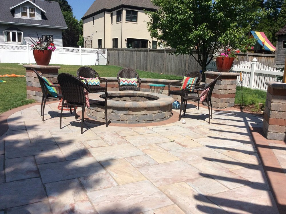 Brick patio and outdoor fireplace redesigned in Naperville, IL