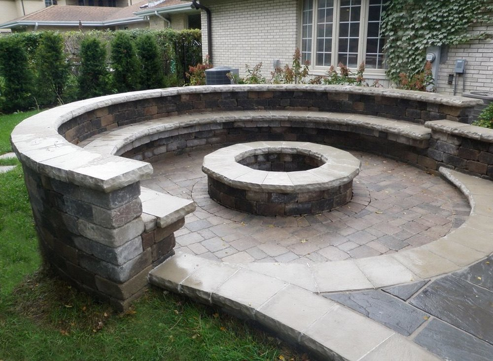 Outdor fireplace and brick paving retaining wall in Plainfield, IL