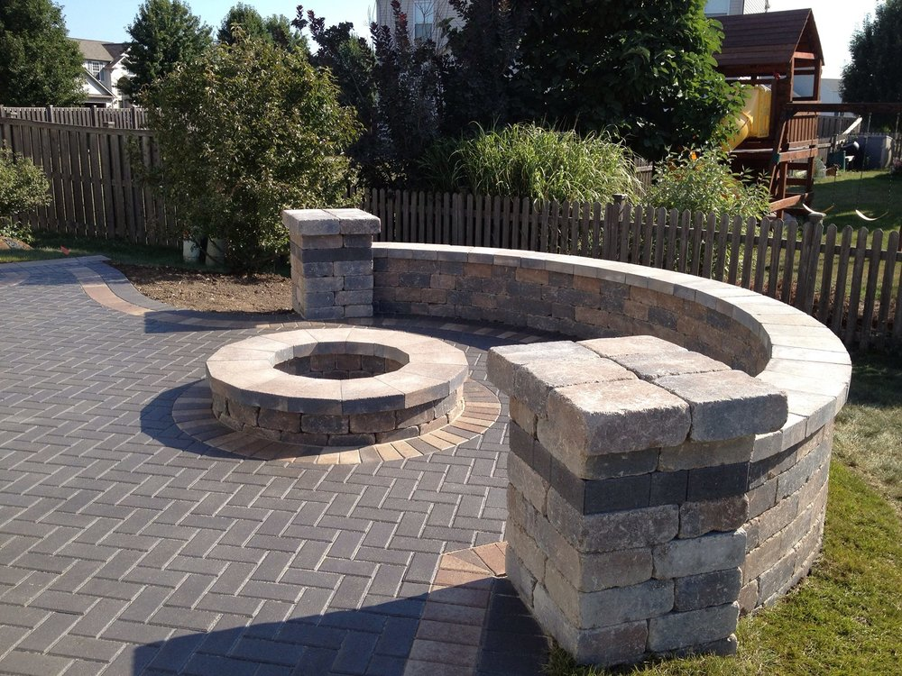 Brick paving retaining wall next to the outdoor fireplace in Burr Ridge, IL