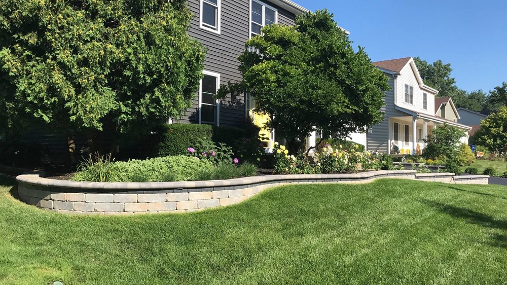 Commercial landscaping maintenance is essential to ensure green grass in Elmhurst, IL