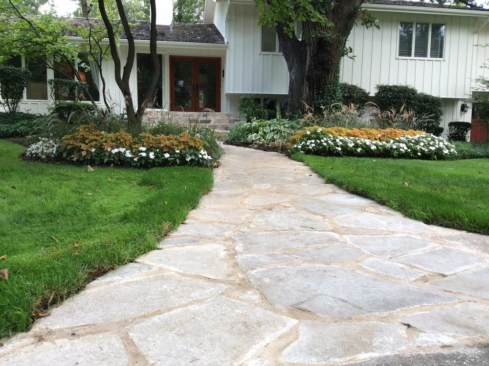Brick paving, sod installation, brick driveway and other landscaping services on display in Oak Brook, IL