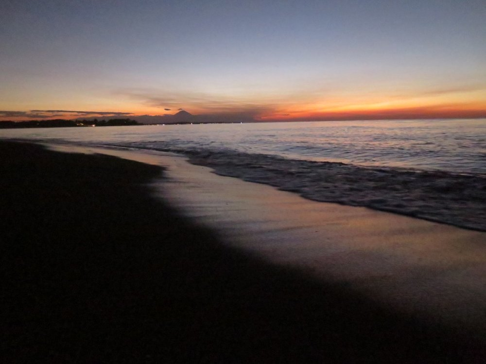 Sunset over one of Lombok's volcanic black sand beaches