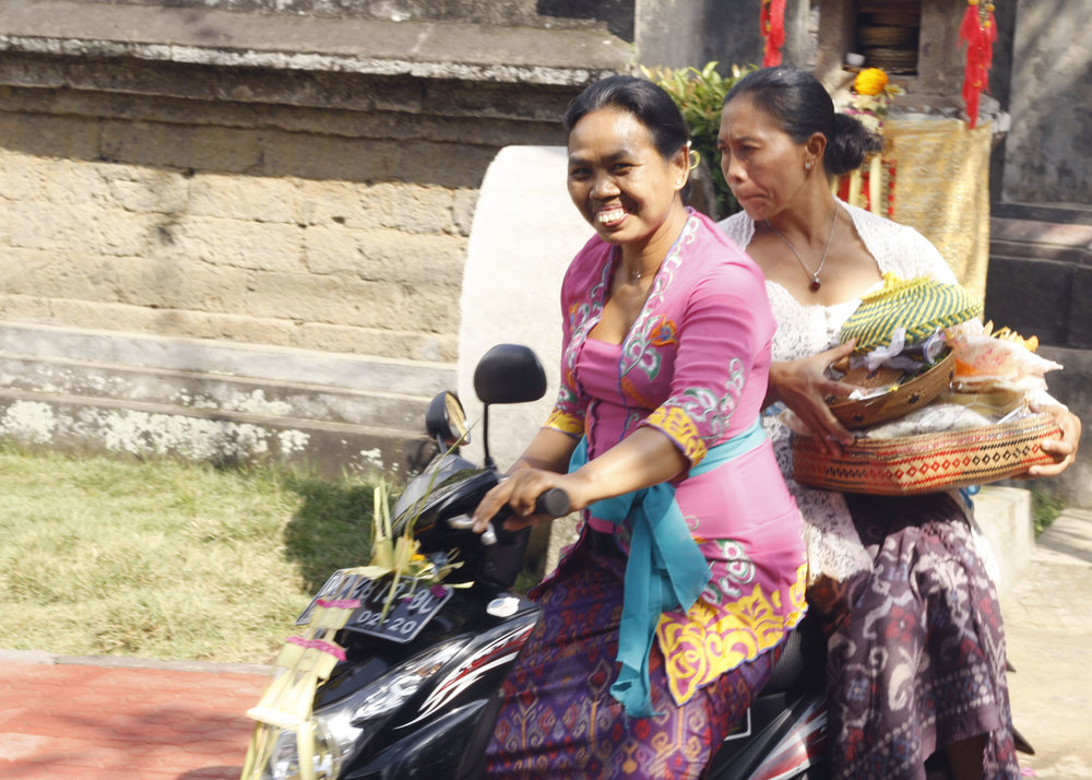 Balinese women dressed beautifully for temple