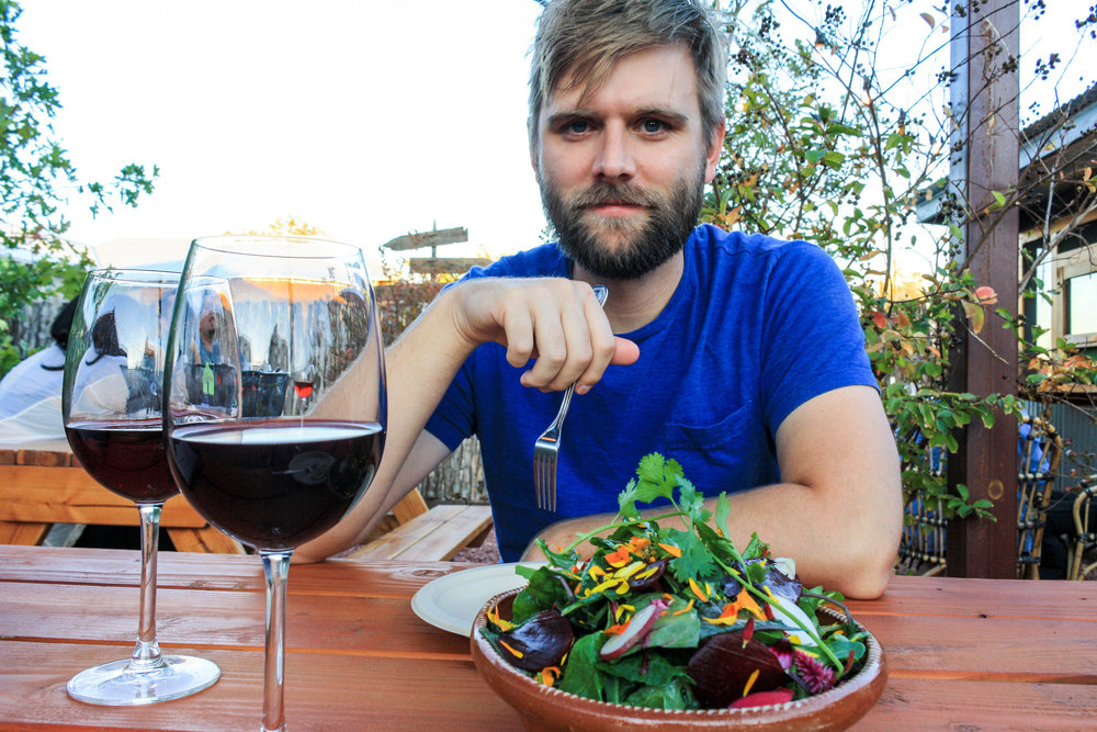 Sometimes balance looks like ordering a heaping salad with your wine.