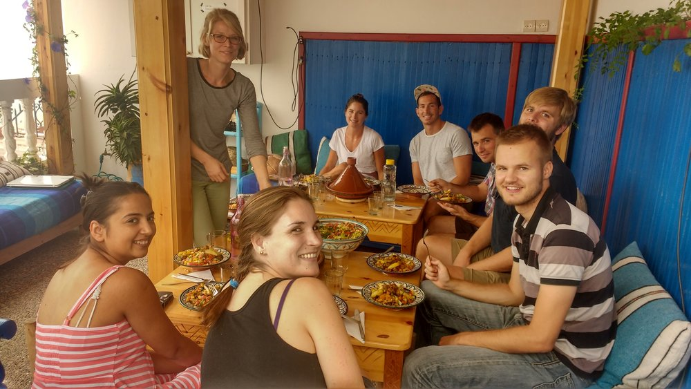 Daily group breakfasts with new friends at Sun Desk, in Taghazout Morocco. Here you can book daily-weekly-monthly coliving or coworking for a reasonable price. Perks include good wifi, support, and plenty of social engagements.