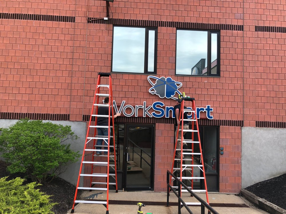 West Signs  installing the WorkSmart sign. Fantastic folks to work with!