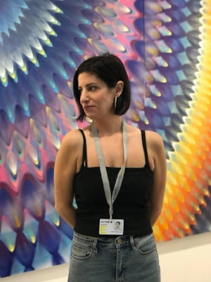 Lauren at Art Basel in Miami 2017. Mural by Hooxxoh