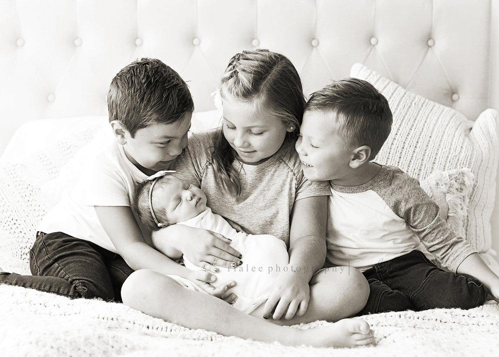 siblingswith baby.jpg