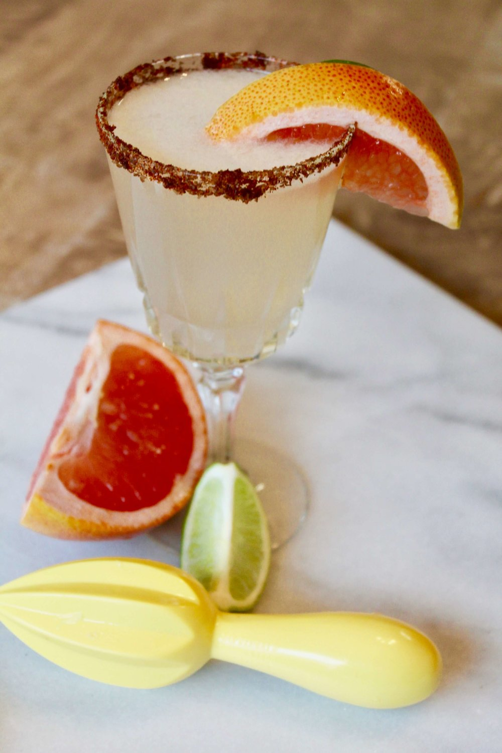 Oh! My Maria Margarita Recipe - Serves 1Ingredients:1 Lime, freshly squeezed1/2 Grapefruit, freshly squeezed1 1/2 Tbsp. Simple Syrup2 shots (or 3 oz.) Tequila1 Tbsp. Smoked Salt1 Tbsp. Chipotle SeasoningInstructions:Fill a cocktail shaker with ice. Add lime juice, grapefruit juice, Simple Syrup and tequila. Cover and shake until mixed and chilled, about 30 seconds. Place Smoked salt and chipotle seasoning on a plate. Use the lime to rim the margarita glass. Press the rim into the smoked salt and chipotle mixture. Strain the margarita into the glass. Garnish with a wedge of lime and grapefruit.