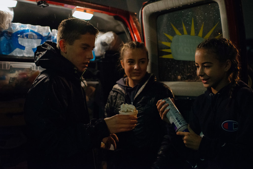 Izzy, Kennedy and their friend, Connor, serving hot chocolate to homeless neighbors.