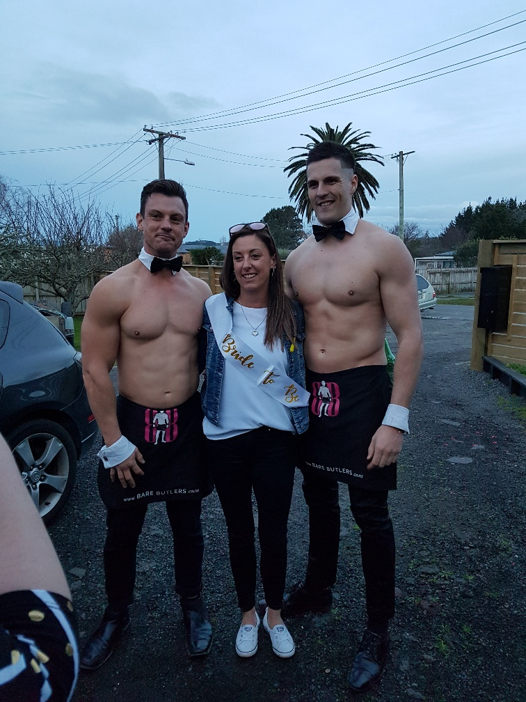 Buff butlers pose with Hen for Hen's party in Auckland