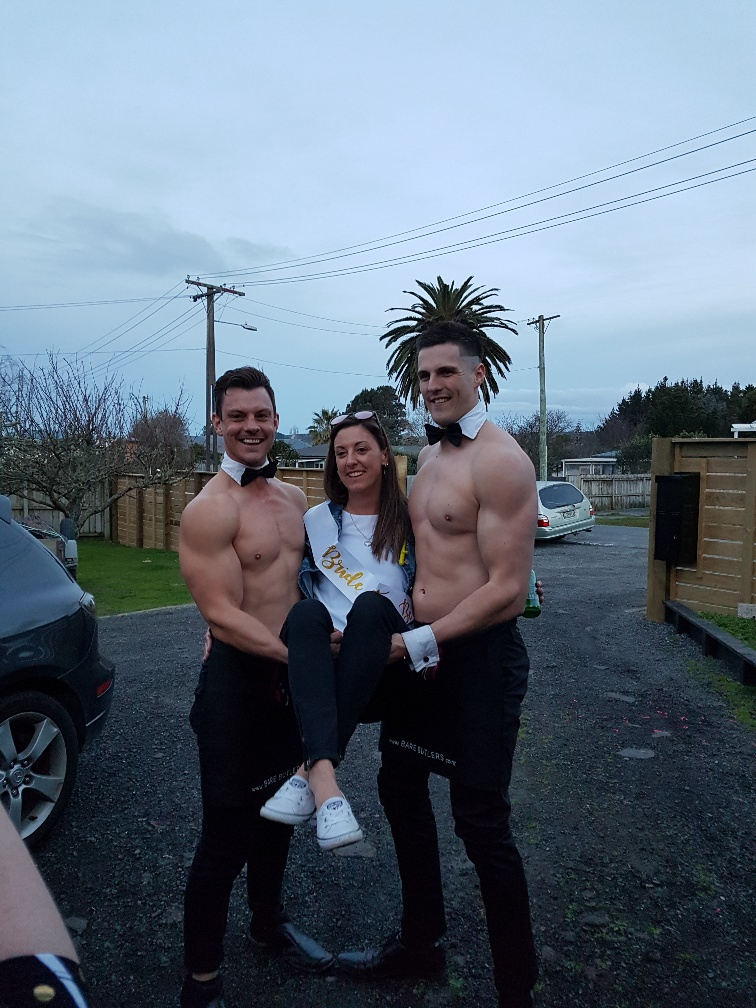 Topless waiters pose for photo with Hen at Hen's party in Auckland