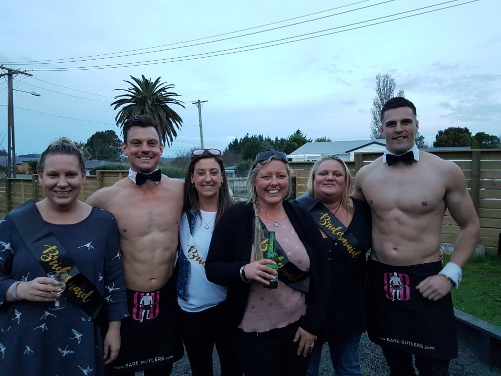 Topless waiters pose with bridesmaids at Hen's party