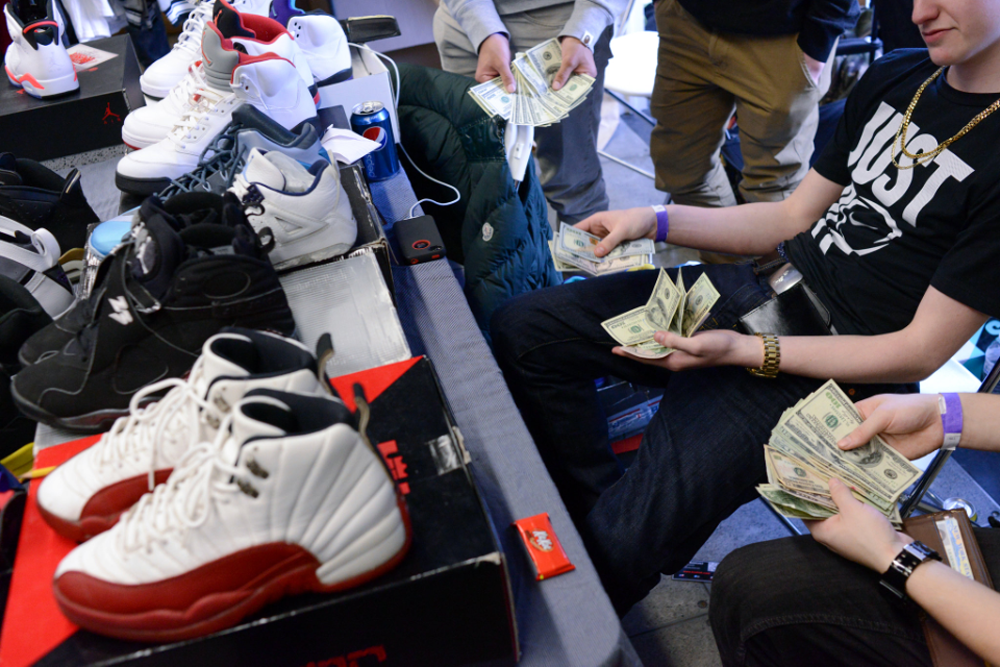 Shoe Dealers Counting Money  Casey Kelbaugh for The New York Times