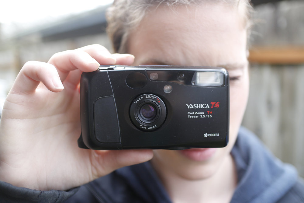 My wife holding my $8 thrift store Yashica T4