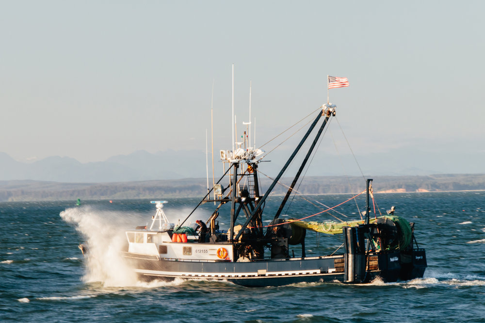 F/V Pacific Future heading out through the incoming tide of Grays Harbor, WA.