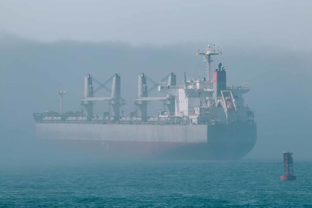 Bulk carrier Geiyo K sailing into a fog bank.
