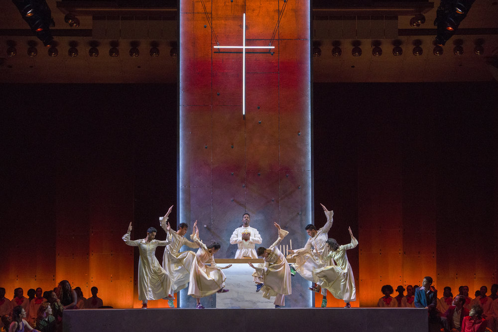 Nmon Ford, the Celebrant, and dancers in Lincoln Center's production of Leonard Bernstein's MASS at the 2018 Mostly Mozart Festival. © Richard Termine.