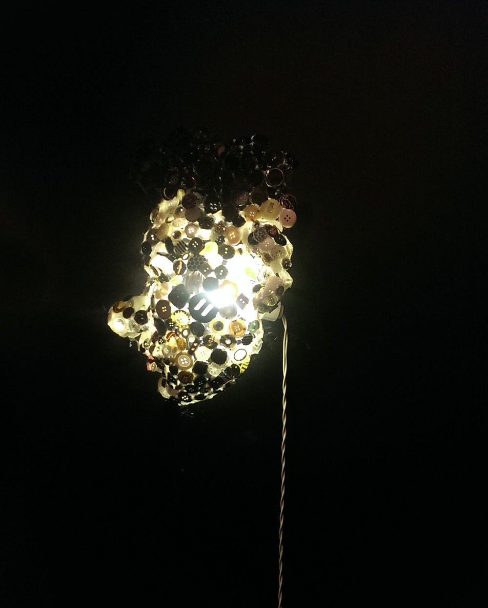 <Self-portrait with buttons and light>  300*400*150mm  May, 2015  Buttons, Light Bulb, Hot Glue