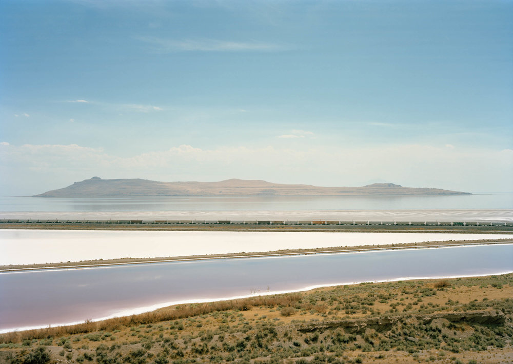 Image © Untitled, ( Train crossing Great Salt Lake, UT ), 2016. (Click to see full image). Courtesy of Victoria Samburanis