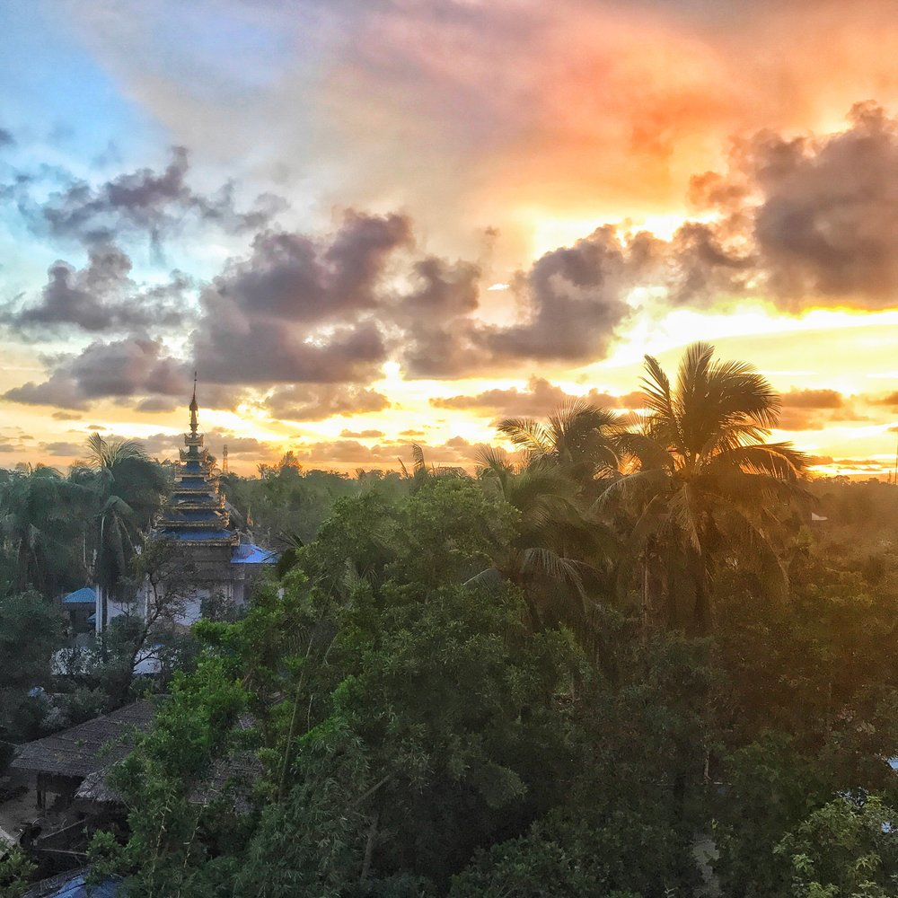 View from rooftop in  Maungdaw, Northern Rakhine State, Myanmar . Taken August 23, 2017, just two nights before the Rohingya humanitarian catastrophe and refugee crisis began. Later that night, distant gunfire was heard, sparking suspicions among colleagues of a larger crisis brewing.  Photo by Ashley S. Kinseth.
